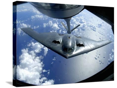 A B-2 Spirit Moves into Position for Refueling from a KC-135 Stratotanker Over the Pacific Ocean-Stocktrek Images-Stretched Canvas Print