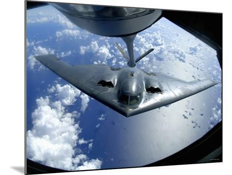 A B-2 Spirit Moves into Position for Refueling from a KC-135 Stratotanker Over the Pacific Ocean-Stocktrek Images-Mounted Photographic Print