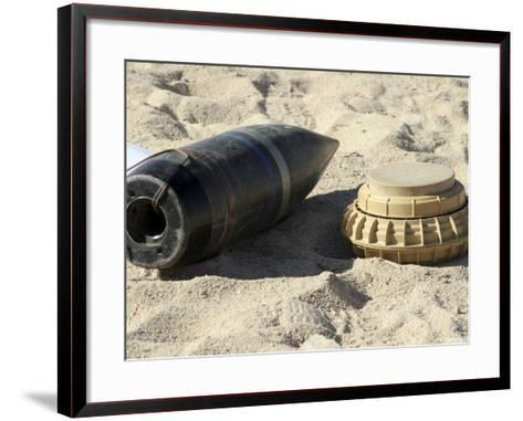 A Static Display of a Converted Ordnance Shell and a Simple Mine-Stocktrek Images-Framed Art Print