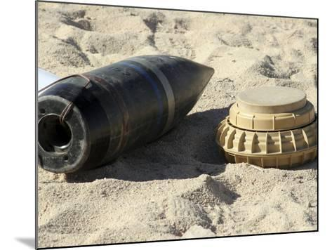 A Static Display of a Converted Ordnance Shell and a Simple Mine-Stocktrek Images-Mounted Photographic Print
