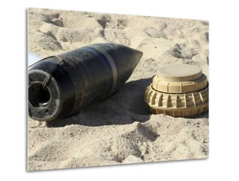 A Static Display of a Converted Ordnance Shell and a Simple Mine-Stocktrek Images-Metal Print