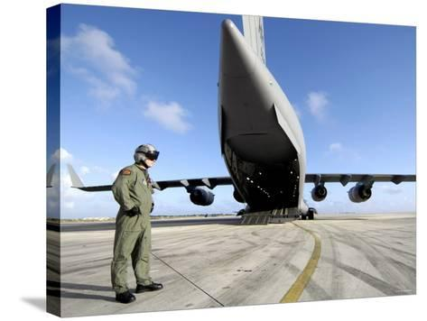 A Soldier Waits for His C-17 Globemaster III to Launch on an Upcoming Airdrop Mission-Stocktrek Images-Stretched Canvas Print