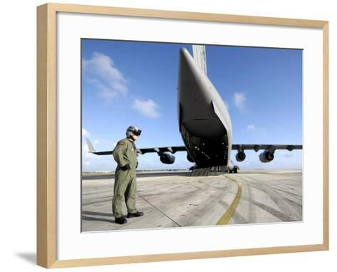 A Soldier Waits for His C-17 Globemaster III to Launch on an Upcoming Airdrop Mission-Stocktrek Images-Framed Art Print