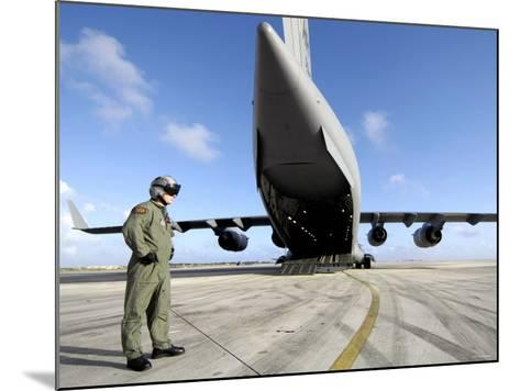 A Soldier Waits for His C-17 Globemaster III to Launch on an Upcoming Airdrop Mission-Stocktrek Images-Mounted Photographic Print