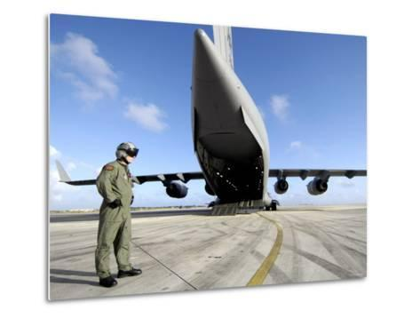 A Soldier Waits for His C-17 Globemaster III to Launch on an Upcoming Airdrop Mission-Stocktrek Images-Metal Print