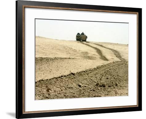 An Amphibious Assault Vehicle Rolls Through a Desert Field North of Fallujah-Stocktrek Images-Framed Art Print