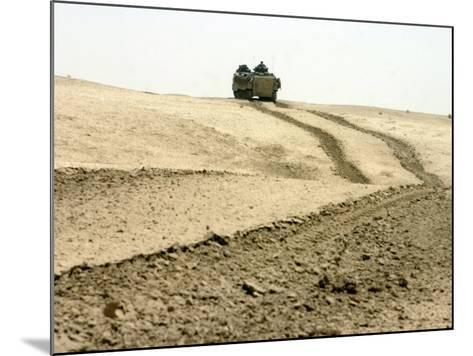 An Amphibious Assault Vehicle Rolls Through a Desert Field North of Fallujah-Stocktrek Images-Mounted Photographic Print