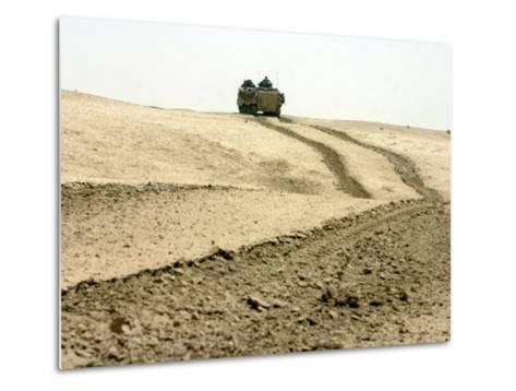 An Amphibious Assault Vehicle Rolls Through a Desert Field North of Fallujah-Stocktrek Images-Metal Print