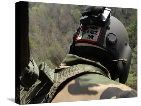 US Army National Guardsman Looks out a UH-60 Black Hawk Helicopter During a Search and Rescue-Stocktrek Images-Stretched Canvas Print