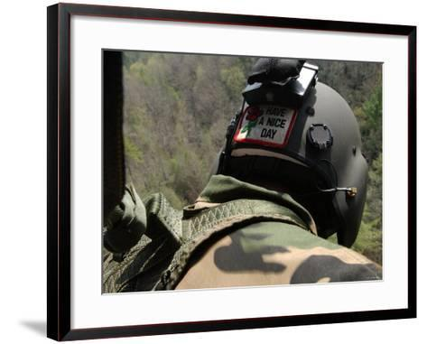 US Army National Guardsman Looks out a UH-60 Black Hawk Helicopter During a Search and Rescue-Stocktrek Images-Framed Art Print