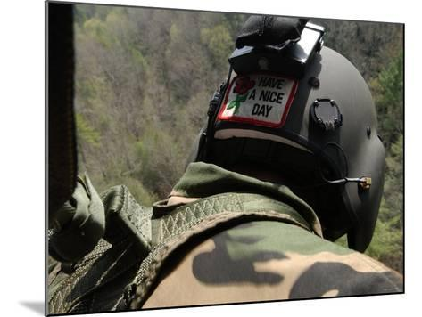 US Army National Guardsman Looks out a UH-60 Black Hawk Helicopter During a Search and Rescue-Stocktrek Images-Mounted Photographic Print