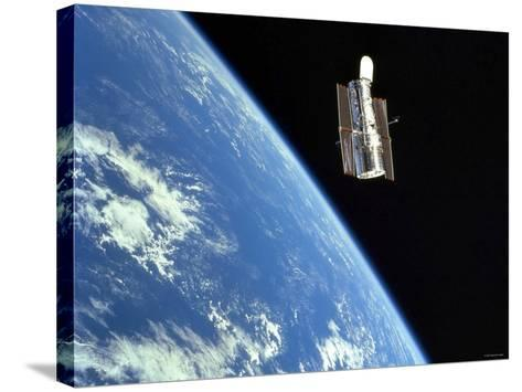 The Hubble Space Telescope with a Blue Earth in the Background-Stocktrek Images-Stretched Canvas Print