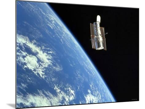 The Hubble Space Telescope with a Blue Earth in the Background-Stocktrek Images-Mounted Photographic Print