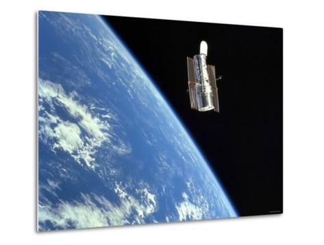 The Hubble Space Telescope with a Blue Earth in the Background-Stocktrek Images-Metal Print