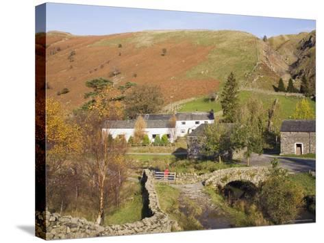 Old Stone Packhorse Bridge Over Watendlath Beck with Dry Stone Wall and Farm Buildings-Pearl Bucknall-Stretched Canvas Print