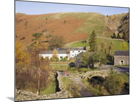Old Stone Packhorse Bridge Over Watendlath Beck with Dry Stone Wall and Farm Buildings-Pearl Bucknall-Mounted Photographic Print
