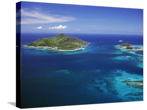 Ile Sainte Anne (St. Anne Island) in Blue Sea, Northeast Coast, Island of Mahe, Indian Ocean-Bruno Barbier-Stretched Canvas Print