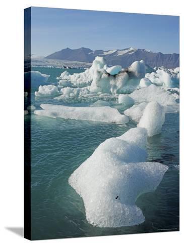 Icebergs in the Glacial Melt Water Lagoon, Jokulsarlon Breidamerkurjokull, South Area, Iceland-Neale Clarke-Stretched Canvas Print