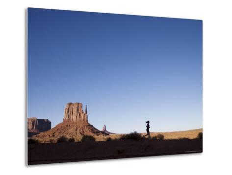 Woman Jogging, Monument Valley Navajo Tribal Park, Utah Arizona Border, USA-Angelo Cavalli-Metal Print