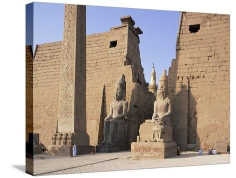 Colossi of Rameses II, Luxor Temple, Luxor, Unesco World Heritage Site, Thebes, Egypt-Peter Scholey-Stretched Canvas Print