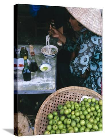 Woman Eating Pho at Food Stall, Cholon Market, Ho Chi Minh City, Indochina-Tim Hall-Stretched Canvas Print
