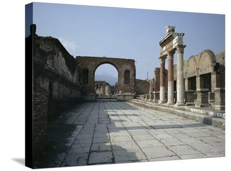 Corner of Forum and Arch of Tiberius, Pompeii, UNESCO World Heritage Site, Campania, Italy-Walter Rawlings-Stretched Canvas Print