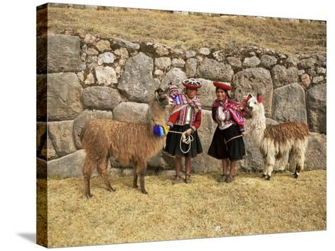 Local Women and Llamas in Front of Inca Ruins, Near Cuzco, Peru, South America-Gavin Hellier-Stretched Canvas Print