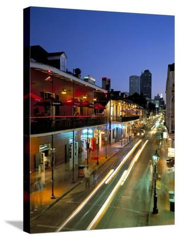Bourbon Street and City Skyline at Night, New Orleans, Louisiana, USA-Gavin Hellier-Stretched Canvas Print