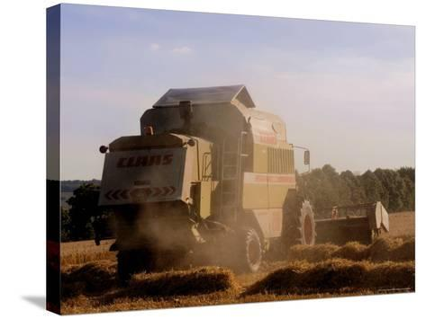 Combine Harvester Baling Hay, Seen from the Cotswolds Way Footpath, the Coltswolds, England-David Hughes-Stretched Canvas Print