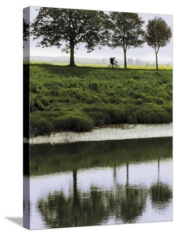Cyclist on Banks of River Somme, St. Valery Sur Somme, Picardy, France-David Hughes-Stretched Canvas Print