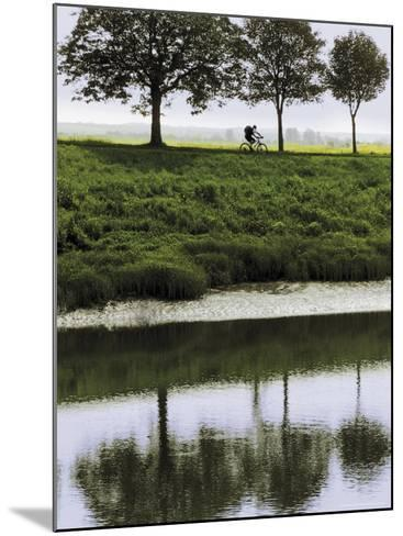 Cyclist on Banks of River Somme, St. Valery Sur Somme, Picardy, France-David Hughes-Mounted Photographic Print
