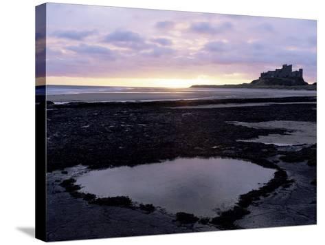 Bamburgh Castle at Sunrise, Bamburgh, Northumberland, England, United Kingdom-Lee Frost-Stretched Canvas Print