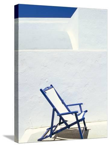Deckchair Against Whitewashed Wall, Imerovigli, Santorini (Thira), Cyclades Islands, Greece-Lee Frost-Stretched Canvas Print
