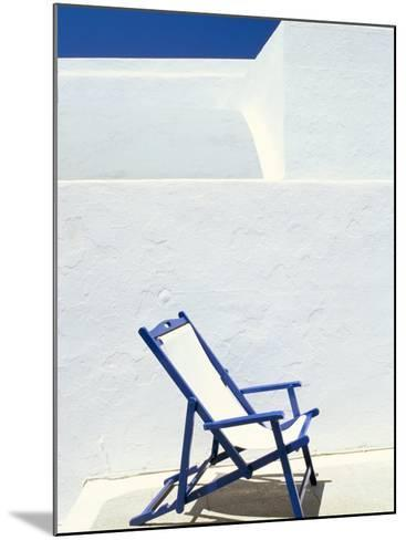 Deckchair Against Whitewashed Wall, Imerovigli, Santorini (Thira), Cyclades Islands, Greece-Lee Frost-Mounted Photographic Print