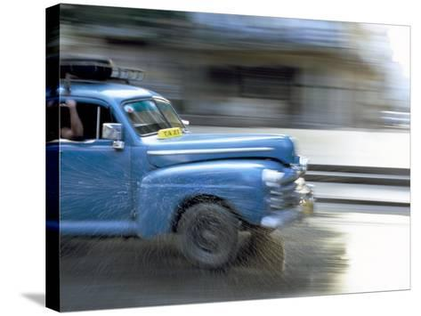 Panned Shot of Old American Car Splashing Through Puddle on Prado, Havana, Cuba, West Indies-Lee Frost-Stretched Canvas Print