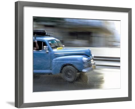 Panned Shot of Old American Car Splashing Through Puddle on Prado, Havana, Cuba, West Indies-Lee Frost-Framed Art Print
