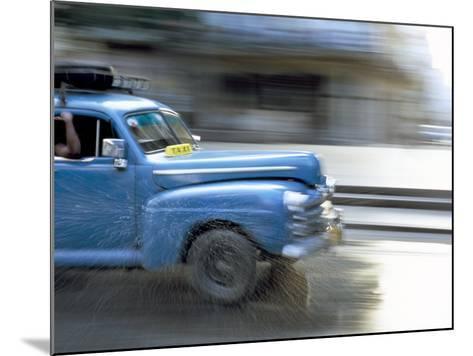 Panned Shot of Old American Car Splashing Through Puddle on Prado, Havana, Cuba, West Indies-Lee Frost-Mounted Photographic Print