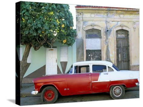 Old American Car Parked on Street Beneath Fruit Tree, Cienfuegos, Cuba, Central America-Lee Frost-Stretched Canvas Print