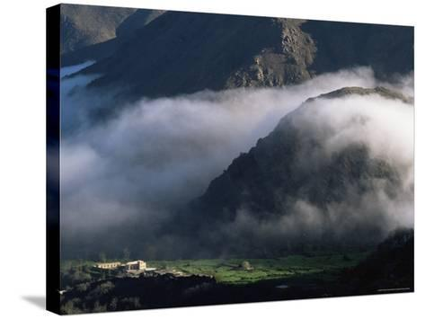 Local School Below Mist Rising in Valley of the High Atlas Mountains, Morocco, North Africa, Africa-David Poole-Stretched Canvas Print
