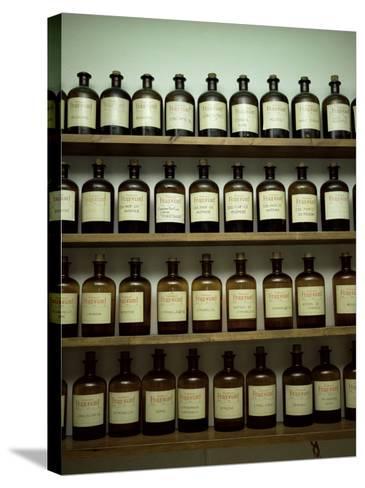 Shelves of Old Essence Bottles, Parfumerie Fragonard, Grasse, Alpes Maritimes, Provence, France-Christopher Rennie-Stretched Canvas Print