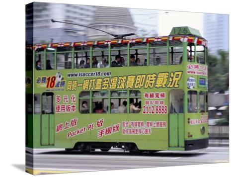 Green Tram, Central, Hong Kong Island, Hong Kong, China-Amanda Hall-Stretched Canvas Print