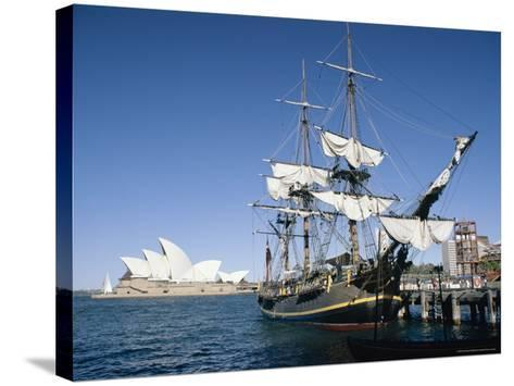 Replica of H.M.S. Bounty and Sydney Opera House, Sydney, New South Wales (N.S.W.), Australia-Amanda Hall-Stretched Canvas Print