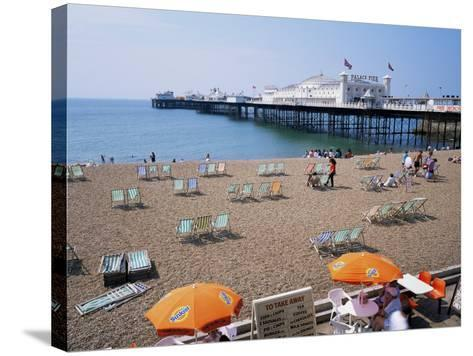 The Palace Pier and Beach, Brighton, Sussex, England, United Kingdom-Roy Rainford-Stretched Canvas Print