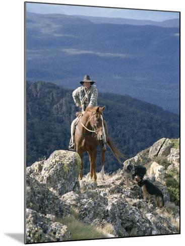 Man on Horse with Dogs, 'The Man from Snowy River', Victoria, Australia-Claire Leimbach-Mounted Photographic Print