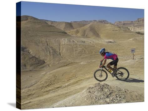 Side View of Competitior in the Mount Sodom International Mountain Bike Race, Dead Sea Area, Israel-Eitan Simanor-Stretched Canvas Print