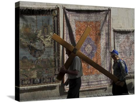 Couple of Pilgrims Carrying a Cross on the Via Dolorosa During Good Friday Catholic Procession-Eitan Simanor-Stretched Canvas Print