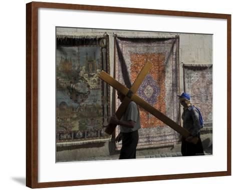 Couple of Pilgrims Carrying a Cross on the Via Dolorosa During Good Friday Catholic Procession-Eitan Simanor-Framed Art Print