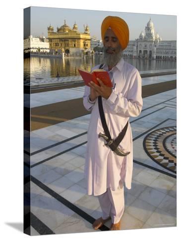Sikh Pilgrim with Orange Turban, White Dress and Dagger, Reading Prayer Book, Amritsar-Eitan Simanor-Stretched Canvas Print