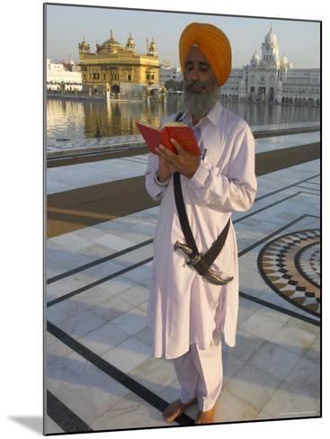 Sikh Pilgrim with Orange Turban, White Dress and Dagger, Reading Prayer Book, Amritsar-Eitan Simanor-Mounted Photographic Print