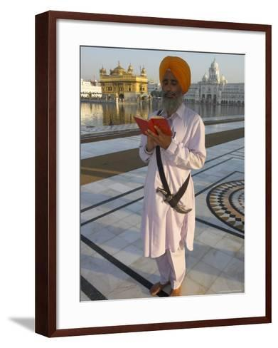 Sikh Pilgrim with Orange Turban, White Dress and Dagger, Reading Prayer Book, Amritsar-Eitan Simanor-Framed Art Print